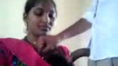South Indian college girl with her teacher in class room