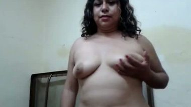 Mature house wife showing her busty figure